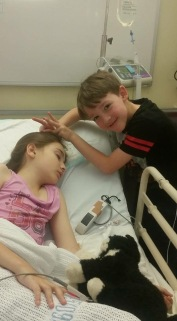 Post appendectomy, Mish is ever the loving little brother.