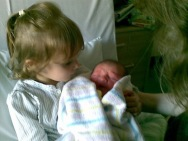 Tilly meeting her baby brother Mish.